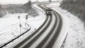 Heavy snowfall on German country road - passing truck. View from a bridge stock video footage