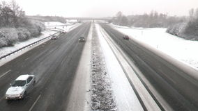Heavy snowfall on German highway stock video