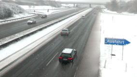 Heavy snowfall on German highway stock footage