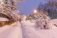 Heavy snowfall in Moscow. houses and streets during blizzard Stock Photo