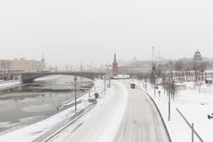 Heavy snowfall in Moscow. Snow-covered roads and Zaryadye Park with a view of the Kremlin and Bolshoy Moskvoretsky Stock Image
