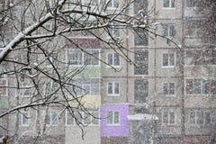 Heavy snowfall opposite windows of residential house Stock Image