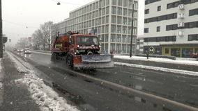 Heavy snowfall and snow plow. Wiesbaden, Germany - December 28, 2014: Middle-aged driver in a snow plow truck of public utility ELW driving on a snowy street stock footage