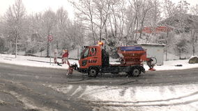Heavy snowfall and snow plow. Wiesbaden, Germany - December 28, 2014: Middle-aged driver in a snow plow truck of public utility ELW driving on a snowy street stock video footage