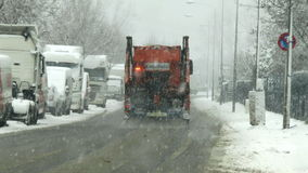 Heavy snowfall and snow plow. Wiesbaden, Germany - December 28, 2014: A snow plow truck of public utility ELW driving on a snowy street during snowfall in the stock video footage