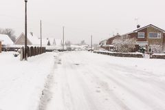 Heavy snowfall in the United Kingdom. Heavy snowfall on a housing estate in the UK with roads blocked by snow and ice Stock Image