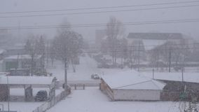 Heavy snowfall in winter in small country town stock footage