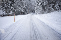 Heavy snowy plowed countryside road Stock Photography