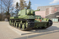The heavy Soviet KV-1 tank at the building of the museum `Break of the Siege of Leningrad` in the May afternoon Royalty Free Stock Photography