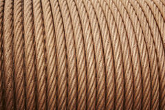Heavy steel coiled greased cable detail in warm tone stock images