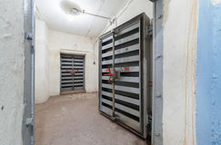 Heavy steel door in the bomb shelter Royalty Free Stock Photography
