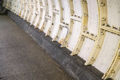 Heavy steel plating on Thames under water tunnel wall.  royalty free stock photography