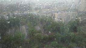 Heavy storm rain through window stock footage