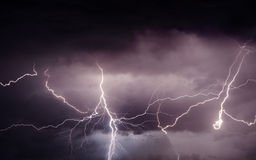 Heavy summer storm bringing thunder, lightnings and rain Stock Photos