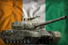 Heavy tank with city camouflage on the Cote d Ivoire national flag background. 3d Illustration. Heavy tank with city camouflage on the Cote d Ivoire flag royalty free illustration