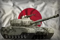 Heavy tank with city pixel camouflage on the Japan national flag background. 3d Illustration. Heavy tank with city pixel camouflage on the Japan flag background royalty free illustration