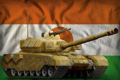Heavy tank with desert camouflage on the Niger national flag background. 3d Illustration. Heavy tank with desert camouflage on the Niger flag background. 3d vector illustration