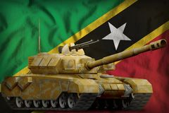 Heavy tank with desert camouflage on the Saint Kitts and Nevis national flag background. 3d Illustration. Heavy tank with desert camouflage on the Saint Kitts stock illustration