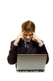 Heavy task. Businessman with laptop at a table Royalty Free Stock Photos