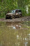 Heavy Terrain Vehicle. Special vehicle meant for racing in heavy terrain conditions crossing a stream on a dirt race track Stock Photos