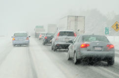 Driving in snow storm. Heavy traffic during a blizzard Royalty Free Stock Photo