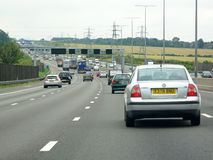 Heavy traffic on british motorway M1. On July 20, 2012, London, UK. The M1 is a north-south motorway in England connecting London to Leeds. The motorway is 193 royalty free stock photo
