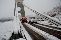 Heavy traffic crossing Clifton Suspension bridge in the snow wit. Clifton, Bristol, UK - January 18, 2013: People struggle to get to work given heavy amounts of Royalty Free Stock Photography