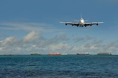 Heavy traffic of global shipping. Plane, vessels Royalty Free Stock Photo
