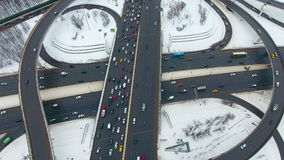 Heavy traffic on a Highway Interchange. Winter. Aerial shot from above. 4K stock video footage