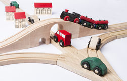 Heavy traffic near small toy town Stock Image