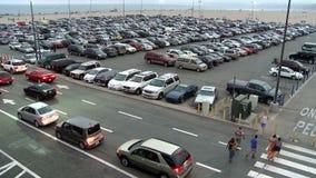 Heavy traffic in parking lot stock video footage