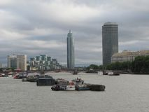 Heavy traffic on the Thames River in London. This view of the Thames River in London, England, taken from Westminster Bridge, reflects the many barges utilized royalty free stock photography