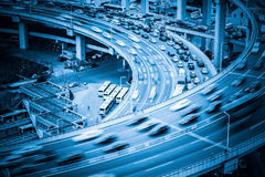 Heavy traffic on viaduct. Heavy traffic closeup , vehicles motion blur on viaduct with blue tone Stock Photography