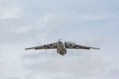 Heavy transport aircraft takes off Stock Images