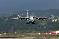 Heavy transport plane takes off. Heavy transport aircraft Ilyushin IL-76MD from the Presidential detachment 224 takes off from the airport of Sochi 09.08.2012 stock image