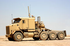 A heavy truck. An armored heavy military truck isolated on a sky background Stock Photo