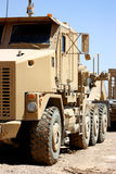 Heavy truck. A heavy armored military truck closeup shot on a clear blue sky background Royalty Free Stock Photo