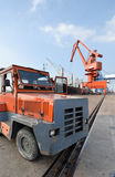 Heavy truck in the harbor. Heavy truck and cranes in the harbor for lading Stock Photos