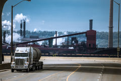 The heavy truck riding from industrial plant Stock Photography
