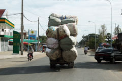 Heavy truckload. A very heavy load on a old truck on a road of cambodia Royalty Free Stock Images