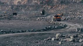 Heavy trucks carry the stone in the quarry mining granite. Heavy trucks carry the stone in a quarry mining granite stock footage