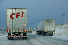 Heavy trucks speeding on icy freeway Royalty Free Stock Photography