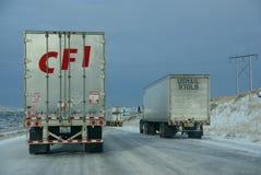 Heavy trucks speeding on icy freeway Royalty Free Stock Photography
