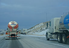 Heavy trucks speeding on icy freeway Stock Photo