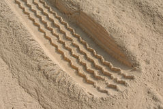 Heavy vehicle tire track on thick dust Royalty Free Stock Photo