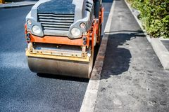 Heavy Vibration roller compactor at asphalt pavement works Stock Photography