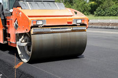 Heavy Vibration roller compactor at asphalt pavement. Works for road repairing Royalty Free Stock Image