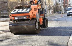Heavy Vibration roller compactor at asphalt pavement works for road repairing. Heavy vibration roller compactor repairs the road on the asphalt surface on the Royalty Free Stock Photos
