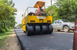 Heavy Vibration roller compactor at asphalt pavement works for road repairing Royalty Free Stock Images