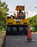 Heavy Vibration roller compactor at asphalt pavement works for road repairing Stock Photos
